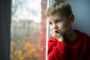 Boy Staring Out Window Email