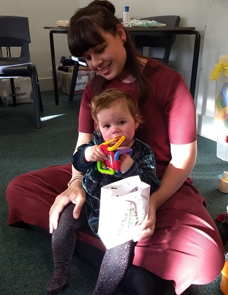 Mother and Child receiving goods for charities